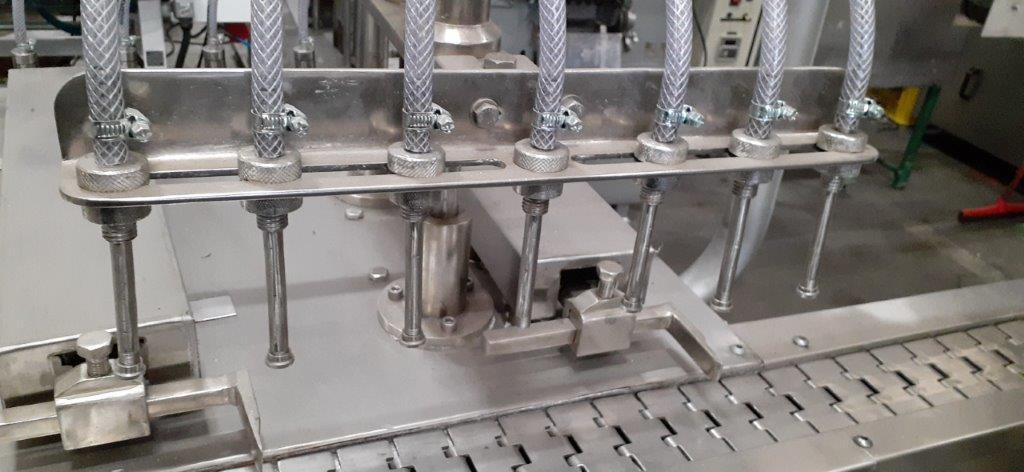 Envasadora automática linear de 7 pistões.